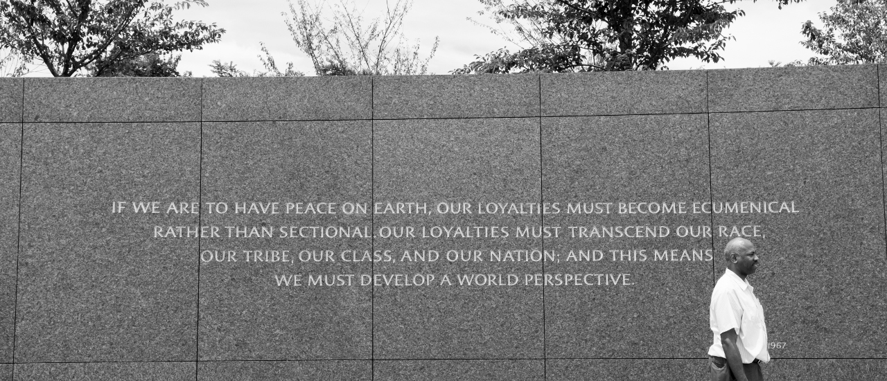 "Man beside quote reading: ""If we are to have peace on earth, our loyalties must become ecumenical rather than sectional. Our loyalties must transcend our race, our tribe, our class, and our nation; and this means we must develop a world perspective."""