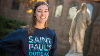 Student wearing a St. Paul's Outreach shirt.