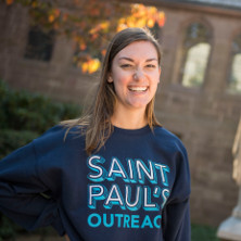 Student wearing a shirt for St. Paul's Outreach