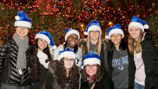 Students in front of the Christmas Tree at the Eight Annual Christmas Tree Lighting ceremony.