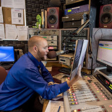 Photo of Timothy Best in a broadcast control room