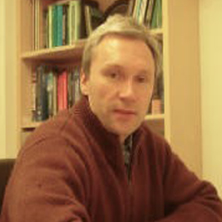 Faculty Headshot of Alexander Fadeev.