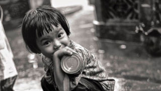Black and white photo of a Vietnamese child during the war