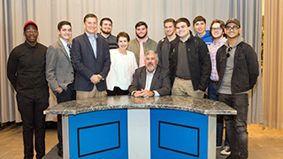 Group photo of students at ESPN Bob Ley's masterclass
