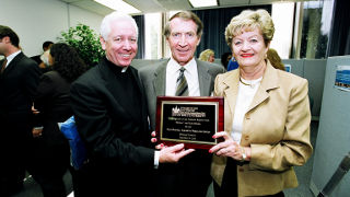 Ruth and Thomas Sharkey receiving a plaque at the dedication of the Ruth Sharkey Academic Resource Center.