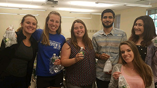 A group photo of Speech Language Pathology students in a lab room.