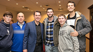 SHU Head Baseball Coach Robert Sheppard and Tom Verducci with students following the panel