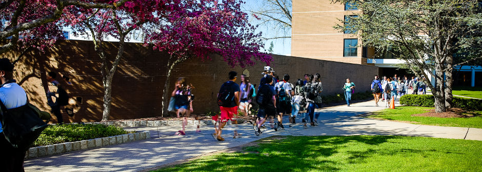 Students walking outside of Xavier Hall.