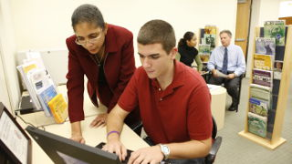 A student and mentor working on a laptop at the Career Center.