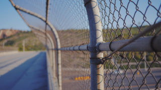 image of chain link fence border wall
