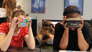 Students using virtual reality glasses in Space 154.