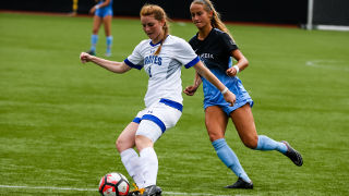 Katie Landes, a graduate student and captain of the women's soccer team, playing soccer.