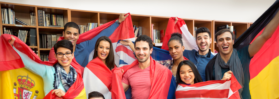 Young adults holding flags from different countries.
