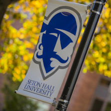 Seton Hall Pirate logo banner with orange leaves in the background