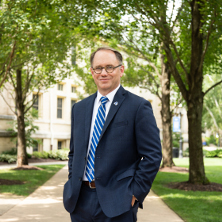 President Joseph Nyre standing in front of Bayley Hall.